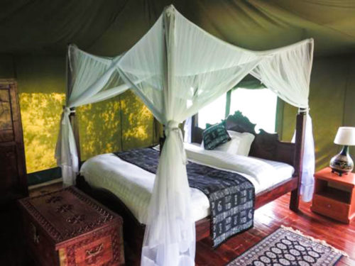 Double bed in a safari tent at the Osero Lodge